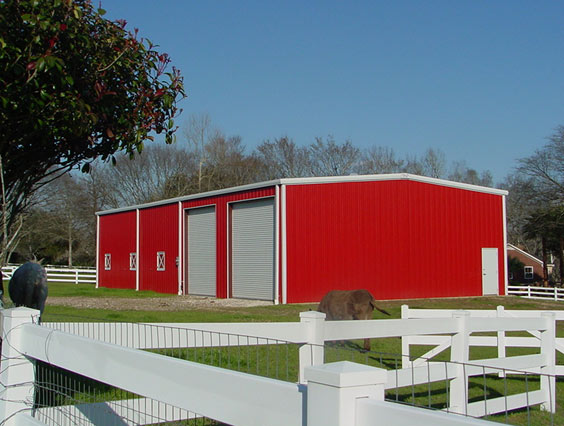 Red Metal Building with White Trim